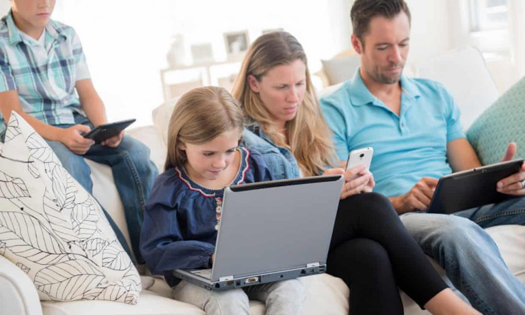 Limit your own screen time, parents are urged